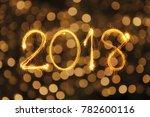 2018 written with sparkle... | Shutterstock . vector #782600116