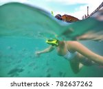 swimming around the shipwrecks  ... | Shutterstock . vector #782637262