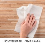 hand of woman wiping wooden... | Shutterstock . vector #782641168