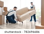delivery men moving sofa in... | Shutterstock . vector #782696686