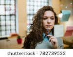 concentrated woman making plan... | Shutterstock . vector #782739532