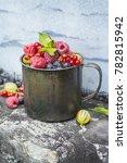 ripe berries in a mug. fruit...   Shutterstock . vector #782815942