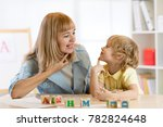 woman teacher and kid boy on... | Shutterstock . vector #782824648