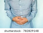 businessman holding his stomach ...   Shutterstock . vector #782829148