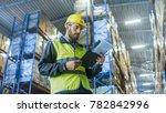 overseer wearing hard hat with... | Shutterstock . vector #782842996