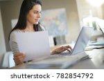 businesswoman in office working ... | Shutterstock . vector #782854792