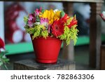 Small photo of Arrangement of colorful flowers.