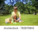 Boy With A Basket Of Easter...