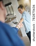 woman pulling man's arm to...   Shutterstock . vector #782875636