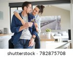 in love couple cheering with... | Shutterstock . vector #782875708