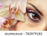 young pretty woman with flower... | Shutterstock . vector #782879182