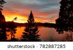 winter sunset over lake... | Shutterstock . vector #782887285