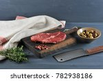 piece of raw beef on a wooden... | Shutterstock . vector #782938186