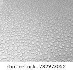 rain drops on the hood after... | Shutterstock . vector #782973052