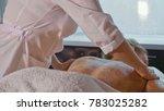 spa therapist applying scrub on ... | Shutterstock . vector #783025282