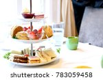 tiered cake stand with finger... | Shutterstock . vector #783059458