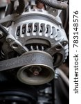 Small photo of details of car engine, alternator or electrical generator