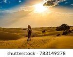woman tourist enjoy camel ride... | Shutterstock . vector #783149278