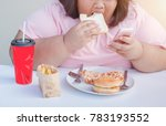overweight woman eating junk... | Shutterstock . vector #783193552