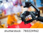 Steadicam with DSLR camera for video production are shooting movie in wedding ceremony. stabilize tool. stabilizer control machine. movie technology. image for background, objects and copy space. - stock photo