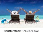 happy couple in sunbeds enjoys... | Shutterstock . vector #783271462