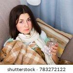 sad girl falls ill and lies at...   Shutterstock . vector #783272122
