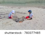 twins playing in the sand on... | Shutterstock . vector #783377485