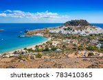 Small photo of View of village, bay and Acropolis of Lindos (Rhodes, Greece)