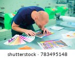 worker in a printing and press... | Shutterstock . vector #783495148