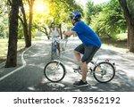 asian teenage boys riding... | Shutterstock . vector #783562192