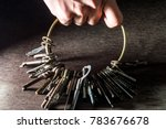 A Hand Holding A Lot Of Keys
