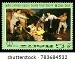 "Small photo of Moscow, Russia - December 30, 2017: A stamp printed in DPRK (North Korea) shows scene ""Death of Kkot Puns Mother"" from Korean Revolutionary opera 'The Flower Girl', circa 1974"