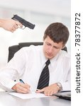Businessman sign a contract under duress - stock photo