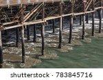 receding waves under and around ... | Shutterstock . vector #783845716