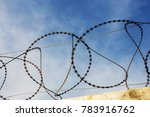 Barbed Wire On Fence Of A...