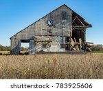 Decaying Barn In A Rural Area.