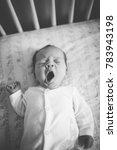 Sleepy Baby Yawning In Crib