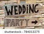 wedding party wooden sign | Shutterstock . vector #784013275
