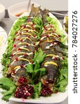 Small photo of sterlet fish, sturgeon (Acipenser ruthenus) prepared in oven