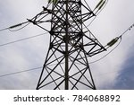 high voltage tower with sky...