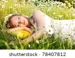 Portrait of pregnant woman on the camomile field - stock photo