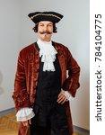 mustachioed eccentric man in... | Shutterstock . vector #784104775