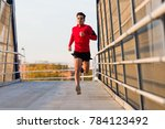 portrait of sporty young man... | Shutterstock . vector #784123492