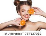 the girl with the tangerine ... | Shutterstock . vector #784127092