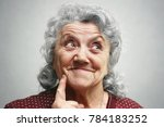 smile and thinking old woman... | Shutterstock . vector #784183252