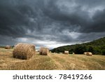 Storm over golden cereal field - stock photo