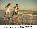 happy family walking on the... | Shutterstock . vector #784227676