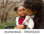 mother kissing her little girl. | Shutterstock . vector #784242322