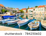 row of fishing boats anchoring... | Shutterstock . vector #784250602