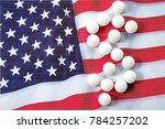 white pills arranged in dollar... | Shutterstock . vector #784257202